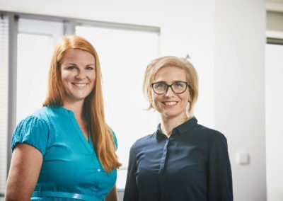 Two women smiling in the camera